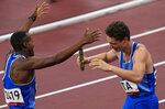 Filippo Tortu, right, and Eseosa Desalu of Italy celebrate after taking the gold medal in the final of the men's 4 x 100-meter relay at the 2020 Summer Olympics, Friday, Aug. 6, 2021, in Tokyo, Japan. (AP Photo/Francisco Seco)