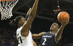 Cincinnati guard Keith Williams (2) tries to shoot over Central Florida forward Chad Brown (21) during the first half of an NCAA college basketball game, Thursday, March 7, 2019, in Orlando, Fla. (AP Photo/Willie J. Allen Jr.)