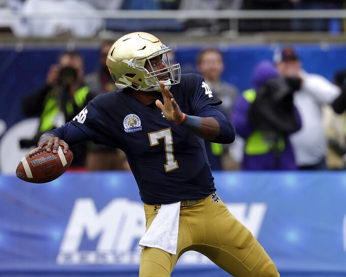 "FILE - In this Jan. 1, 2018, file photo, Notre Dame quarterback Brandon Wimbush (7) throws a pass against LSU during the first half of the Citrus Bowl NCAA college football game,  in Orlando, Fla. Wimbush won't need to look over his shoulder Saturday night when No. 12 Notre Dame hosts No. 14 Michigan in the season opener for both teams. Coach Brian Kelly reiterated the senior is his No. 1 quarterback. ""Brandon's our starter,"" Kelly said Tuesday, Aug. 28, 2018.(AP Photo/John Raoux, File)"