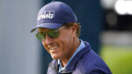 Phil Mickelson smiles as he heads to the range prior to a practice round before the U.S. Open Championship golf tournament, Tuesday, Sept. 15, 2020, at the Winged Foot Golf Club in Mamaroneck, N.Y. (AP Photo/Charles Krupa)