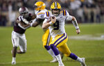 LSU quarterback Joe Burrow (9) rushes for a touchdown against Texas A&M during the first half of an NCAA college football game Saturday, Nov. 24, 2018, in College Station, Texas. (AP Photo/David J. Phillip)