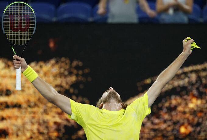 Greece's Stefanos Tsitsipas celebrates after defeating Australia's Thanais Kokkinakis in their second round match at the Australian Open tennis championship in Melbourne, Australia, Thursday, Feb. 11, 2021.(AP Photo/Rick Rycroft)
