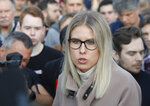 Russian opposition candidate and lawyer at the Foundation for Fighting Corruption Lyubov Sobol speaks to a crowd during a protest in Moscow, Russia, Monday, July 15, 2019. Opposition candidates who run for seats in the city legislature in September's elections have complained that authorities try to bar them from the race by questioning the validity of signatures of city residents they must collect in order to qualify for the race. (AP Photo/Pavel Golovkin)