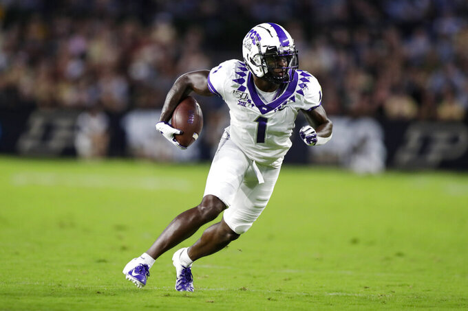 TCU wide receiver Jalen Reagor runs after a catch against Purdue during the first half of an NCAA college football game in West Lafayette, Ind., Saturday, Sept. 14, 2019. (AP Photo/Michael Conroy)