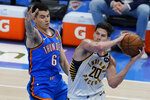 Indiana Pacers forward Doug McDermott (20) passes in front of Oklahoma City Thunder forward Gabriel Deck (6) in the second half of an NBA basketball game Saturday, May 1, 2021, in Oklahoma City. (AP Photo/Sue Ogrocki)