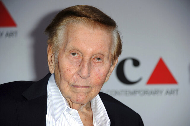 FILE - In this April 20, 2013, file photo, media mogul Sumner Redstone arrives at the 2013 MOCA Gala celebrating the opening of the Urs Fischer exhibition at MOCA, in Los Angeles.  Redstone, the strong-willed media mogul whose public disputes with family members and subordinates made him a feared operator in Hollywood, died Wednesday, Aug. 12, 2020. (Photo by Richard Shotwell/Invision/AP, File)
