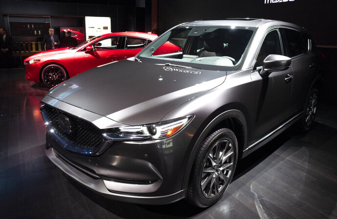 FILE - In this April 17, 2019 file photo, the 2019 Mazda CX-5 is shown at the New York Auto Show.  In its annual auto reliability survey, Consumer Reports found that while newly redesigned models have the latest safety and fuel-economy technology, they also come with glitches that frustrate owners. Overall, Japanese brands Lexus, Mazda and Toyota led the reliability rankings, followed by Porsche and Genesis. Rounding out the top 10 were Hyundai, Subaru, Dodge, Kia and Mini. (AP Photo/Mark Lennihan, File)