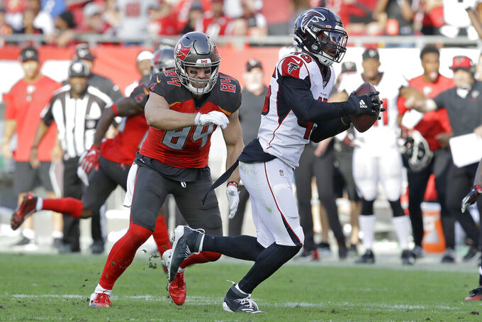 Atlanta Falcons linebacker Deion Jones (45) intercepts a pass by Tampa Bay Buccaneers quarterback Jameis Winston intended for tight end Cameron Brate (84) and returns it for the game-winning touchdown during the overtime of an NFL football game Sunday, Dec. 29, 2019, in Tampa, Fla. (AP Photo/Chris O'Meara)
