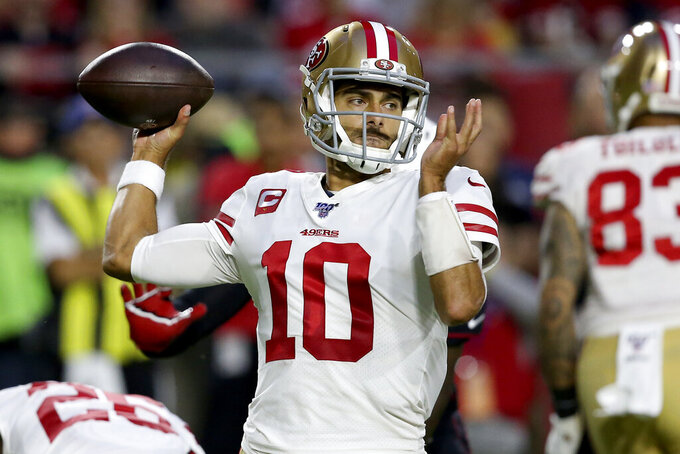 San Francisco 49ers quarterback Jimmy Garoppolo (10) throws against the Arizona Cardinals during the first half of an NFL football game, Thursday, Oct. 31, 2019, in Glendale, Ariz. (AP Photo/Ross D. Franklin)