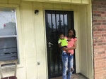 In this May 9, 2018 photo, Starr Jones, 21, stands outside her Shelby, Miss., apartment with her 9-month-old son, Jarvis Kemp, after talking with the nonprofit group Save the Children about her community work to fight poverty. The U.S. Census Bureau is using new high tech tools like aerial imagery to help get an accurate 2020 Census and avoid undercounting communities struggling with poverty. (AP Photo/Russell Contreras)