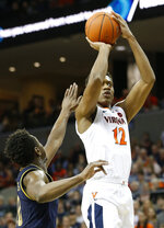 Virginia guard De'Andre Hunter (12) takes a shot over Notre Dame guard TJ Gibbs (10) during the second half of an NCAA college basketball game in Charlottesville, Va., Saturday, Feb. 16, 2019. Virginia beat Notre Dame 60-54. (AP Photo/Steve Helber)