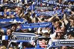 Hamburg fans support their team  during the German Bundesliga soccer match between Hamburger SV and SC Freiburg, in Hamburg, Germany, Saturday, April 21, 2018. (Christian Charisius/dpa via AP)