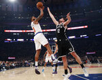 New York Knicks forward Marcus Morris Sr. (13) shoots with Brooklyn Nets forward Joe Harris (12) defending during the first half of an NBA basketball game in New York, Sunday, Jan. 26, 2020. (AP Photo/Kathy Willens)