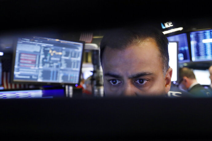 FILE - In this Nov. 20, 2019, file photo specialist Dilip Patel watches the screens at his post on the floor of the New York Stock Exchange. The U.S. stock market opens at 9:30 a.m. EST on Wednesday, Nov 27. (AP Photo/Richard Drew, File)