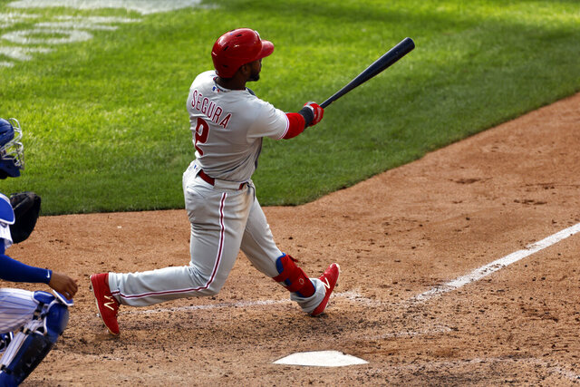 Philadelphia Phillies' Jean Segura hits a two-run home run during the 10th inning of a baseball game against the New York Mets on Monday, Sept. 7, 2020, in New York. (AP Photo/Adam Hunger)