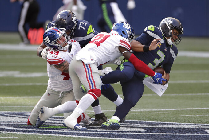 Seattle Seahawks quarterback Russell Wilson (3) is sacked by New York Giants safety Jabrill Peppers (21), during the first half of an NFL football game, Sunday, Dec. 6, 2020, in Seattle. (AP Photo/Larry Maurer)