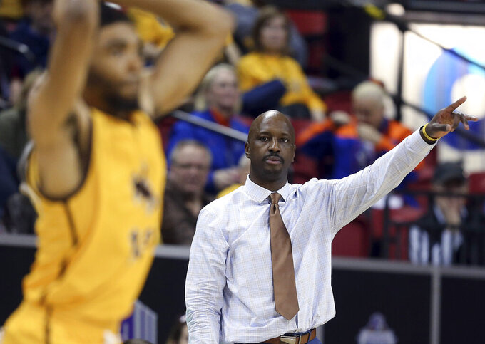 Wyoming coach Allen Edwards gestures during the second half of the team's NCAA college basketball game against New Mexico in the Mountain West Conference men's tournament Wednesday, March 13, 2019, in Las Vegas. (AP Photo/Isaac Brekken)