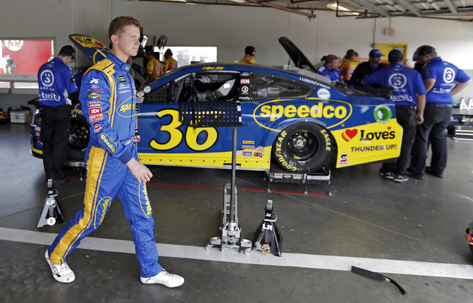 Matt Tifft leaves his garage after a practice session for the NASCAR Daytona 500 auto race at Daytona International Speedway, Friday, Feb. 15, 2019, in Daytona Beach, Fla. (AP Photo/John Raoux)