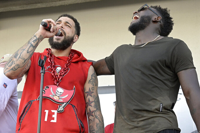 Tampa Bay Buccaneers receivers Mike Evans, left, and Chris Godwin take part in a celebration of the team's Super Bowl 55 victory over the Kansas City Chiefs, following a boat parade Wednesday, Feb. 10, 2021, in Tampa, Fla. (AP Photo/Phelan M. Ebenhack)