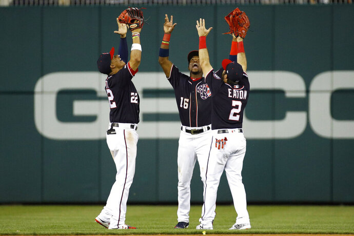 From left to right, Washington Nationals outfielders Juan Soto, Victor Robles and Adam Eaton celebrate after a baseball game against the Miami Marlins, Friday, May 24, 2019, in Washington. (AP Photo/Patrick Semansky)