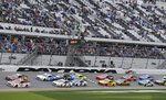 Paul Menard (21) and Kyle Busch, top left, lead the field of cars to start the NASCAR Clash auto race at Daytona International Speedway, Sunday, Feb. 10, 2019, in Daytona Beach, Fla. (AP Photo/Terry Renna)