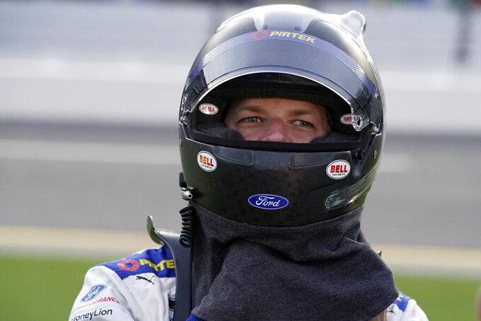 Brad Keselowski adjusts his helmet before the NASCAR Cup Series auto race at Daytona International Speedway, Saturday, Aug. 28, 2021, in Daytona Beach, Fla. (AP Photo/John Raoux)