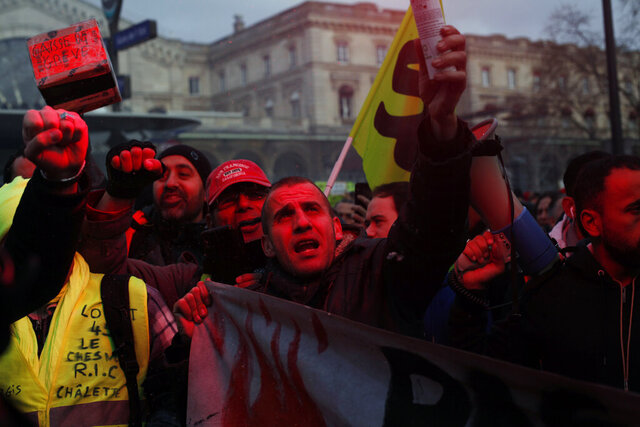 French union members and workers demonstrate after 22 days on a strike against pension reform plans, in Paris, Thursday, Dec. 26, 2019. France's punishing transportation troubles may ease up slightly over Christmas, but unions plan renewed strikes and protests in January to resist government plans to raise the retirement age to 64. (AP Photo/Thibault Camus)