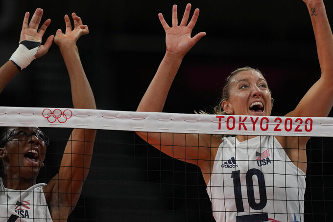United States' Foluke Akinradewo, left, and United States' Jordan Larson try to block during the women's volleyball preliminary round pool B match between United States and Russian Olympic Committee at the 2020 Summer Olympics, Saturday, July 31, 2021, in Tokyo, Japan. (AP Photo/Frank Augstein)