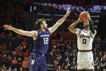 Illinois' Alan Griffin (0) shoots as Northwestern's Pat Spencer (12) defends in the first half of an NCAA college basketball game, Saturday Jan. 18, 2020, in Champaign, Ill. (AP Photo/Holly Hart)