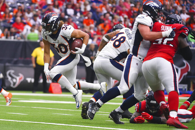 Denver Broncos running back Phillip Lindsay (30) runs for a touchdown against the Houston Texans during the second half of an NFL football game Sunday, Dec. 8, 2019, in Houston. (AP Photo/Eric Christian Smith)