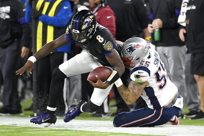 Baltimore Ravens quarterback Lamar Jackson (8) is tackled by New England Patriots defensive end John Simon (55) during the first half of an NFL football game, Sunday, Nov. 3, 2019, in Baltimore. (AP Photo/Nick Wass)