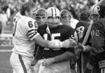 FILE - In this Nov. 16, 1970, file photo, Chicago Bears' Lee Roy Caffey (60) congratulates Green Bay Packers quarterback Bart Starr after Starr scored the winning touchdown at a football game in Green Bay, Wisc. Starr, the Green Bay Packers quarterback and catalyst of Vince Lombardi's powerhouse teams of the 1960s, has died. He was 85. The Packers announced Sunday, May 26, 2019, that Starr had died, citing his family. He had been in failing health since suffering a serious stroke in 2014. (AP Photo/PJS)