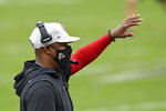 Atlanta Falcons head coach Raheem Morris calls a play during the second half of an NFL football game against the Tampa Bay Buccaneers Sunday, Jan. 3, 2021, in Tampa, Fla. (AP Photo/Jason Behnken)