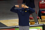 Michigan coach Juwan Howard reacts during the first half of the team's NCAA college basketball game against Maryland, Thursday, Dec. 31, 2020, in College Park, Md. (AP Photo/Nick Wass)
