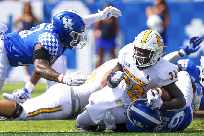 Chattanooga running back Ailym Ford (32) is tackled during the second half of a NCAA college football game against Kentucky in Lexington, Ky., Saturday, Sept. 18, 2021. (AP Photo/Michael Clubb)