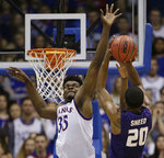 Kansas' Udoka Azubuike (35) tries to block a shot by Kansas State's Xavier Sneed during the first half of an NCAA college basketball game Saturday, Jan. 13, 2018, in Lawrence, Kan. (AP Photo/Charlie Riedel)