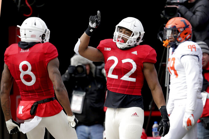 Nebraska running back Devine Ozigbo (22) celebrates his touchdown with wide receiver Stanley Morgan Jr. (8) as Illinois defensive lineman Owen Carney Jr. (99) looks on, during the first half of an NCAA college football game in Lincoln, Neb., Saturday, Nov. 10, 2018. (AP Photo/Nati Harnik)