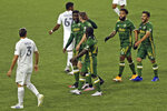 Portland Timbers players celebrate Jaroslaw Niezgoda's goal against the LA Galaxy during the first half of an MLS soccer match Wednesday, Oct. 28, 2020, in Portland, Ore. (Sean Meagher/The Oregonian via AP)