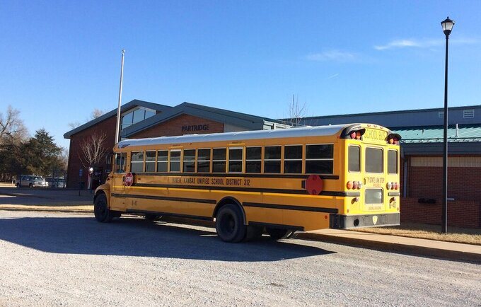 A school bus outside Haven Unified School District 312 in 2018, in Haven, Kan. Earlier this year, a board member in Haven introduced a proposal to restrict the teaching of race, sex and gender. (Mary Clarkin/The Topeka Capital-Journal via AP)