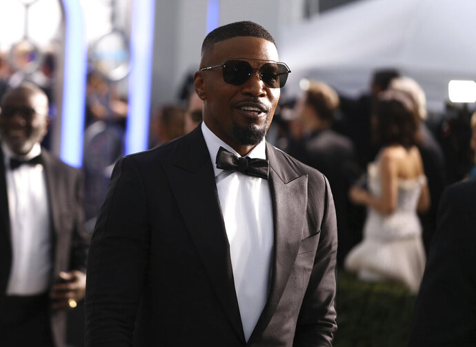 Jamie Foxx arrives at the 26th annual Screen Actors Guild Awards at the Shrine Auditorium & Expo Hall on Sunday, Jan. 19, 2020, in Los Angeles. (Photo by Matt Sayles/Invision/AP)
