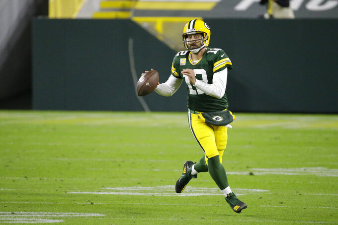 Green Bay Packers quarterback Aaron Rodgers (12) looks to throw during the second half of an NFL football game against the Atlanta Falcons, Monday, Oct. 5, 2020, in Green Bay, Wis. (AP Photo/Mike Roemer)