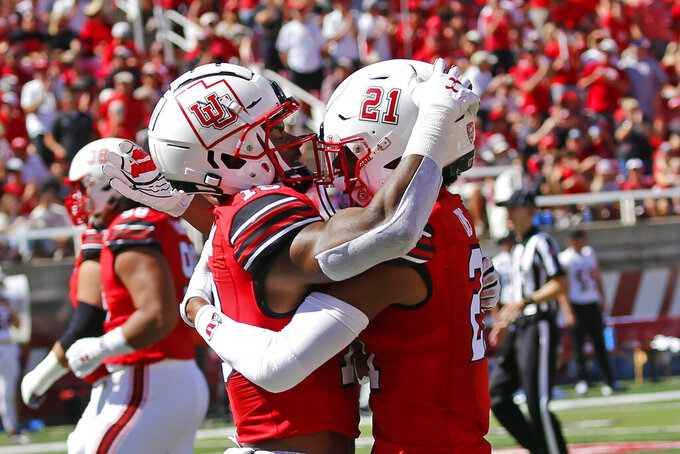 Utah wide receiver Bryan Thompson, left, celebrates with teammate Solomon Enis (21) after scoring against Idaho State in the first half of an NCAA college football game Saturday, Sept. 14, 2019, in Salt Lake City. (AP Photo/Rick Bowmer)