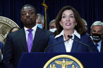 """New York Gov. Kathy Hochul, accompanied by Lt. Gov. Brian Benjamin, left, speaks before signing the """"Less is More"""" law, during ceremonies in the governor's office, in New York, Friday, Sept. 17, 2021. New Yorkers will be able to avoid jail time for most nonviolent parole violations under a new law that will take effect in March, and largely eliminates New York's practice of incarcerating people for technical parole violations. (AP Photo/Richard Drew)"""