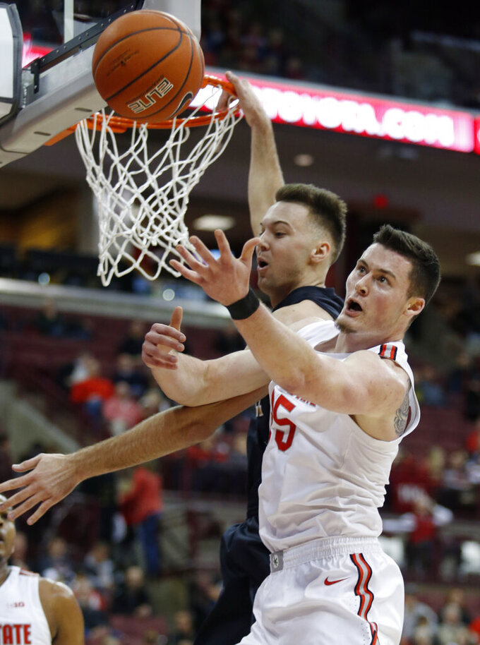 Ohio State forward Kyle Young, right, reaches for a rebound in front of Purdue Fort Wayne forward Dylan Carl during the first half of an NCAA college basketball game in Columbus, Ohio, Friday, Nov. 22, 2019. (AP Photo/Paul Vernon)