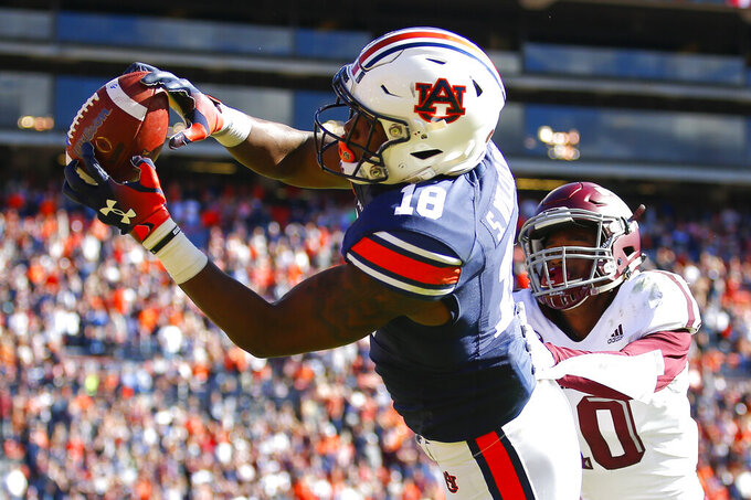 FILE - In this Nov. 3, 2018, file photo, Auburn wide receiver Seth Williams (18) reaches for a touchdown reception as Texas A&M defensive back Myles Jones (10) defends during the second half of an NCAA college football game in Auburn, Ala. Williams emerged as a playmaker his freshman season and appears poised for an even bigger role this year following the departures of Ryan Davis and Darius Slayton. (AP Photo/Todd Kirkland, File)