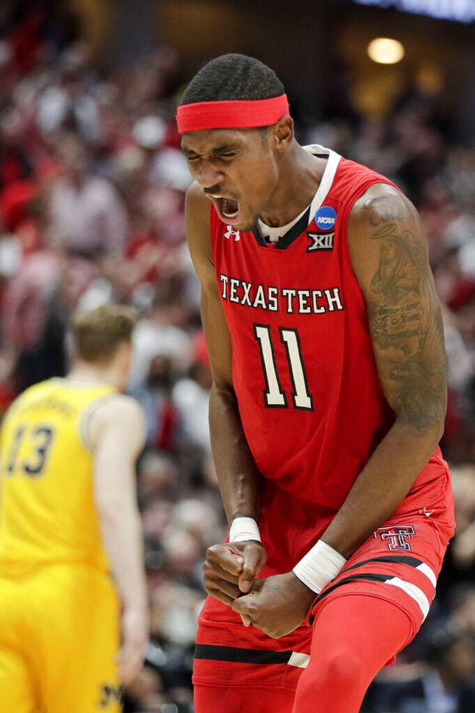 Texas Tech forward Tariq Owens -celebrates after scoring against Michigan during the second half an NCAA men's college basketball tournament West Region semifinal Thursday, March 28, 2019, in Anaheim, Calif. (AP Photo/Jae C. Hong)