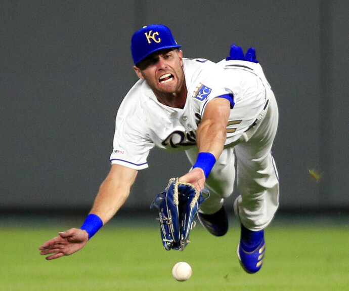 Kansas City Royals center fielder Bubba Starling fails to catch a fly ball hit by Detroit Tigers' Victor Reyes during the fifth inning of a baseball game at Kauffman Stadium in Kansas City, Mo., Friday, July 12, 2019. It was an RBI-double for Reyes on the play. (AP Photo/Orlin Wagner)