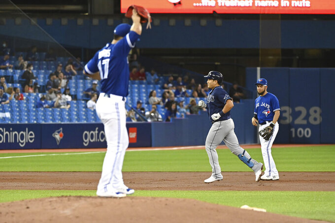 Tampa Bay Rays' Ji-Man Choi, middle, runs the bases after hitting a solo home run off Toronto Blue Jays starting pitcher Jose Berrios (17) during the second inning of a baseball game Tuesday, Sept. 14, 2021, in Toronto. (Jon Blacker/The Canadian Press via AP)