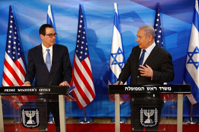 Israeli Prime Minister Benjamin Netanyahu and U.S. Treasury Secretary Steven Mnuchin deliver joint statements during their meeting in Jerusalem, Monday, Oct. 28, 2019. (Ronen Zvulun/Pool Photo via AP)