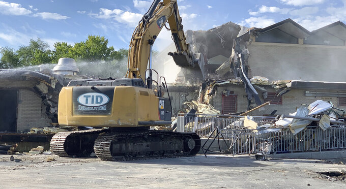 In this Monday, Sept. 13, 2021, photo demolition crews tear down the Wasatch Youth Center, the former long-term, secure lockup for child offenders in Salt Lake City, Utah. (Ben Winslow/KSTU Fox 13 via AP)
